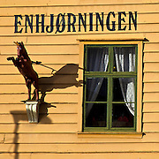 Detail of Bergen's Wharfhouse no.1, today called Enhjørningen (unicorn) Fishrestaurant, on the Hanseatic wharf (Bryggen), a UNESCO World Heritage site.