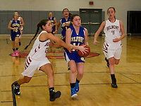 Belmont's Courtney Clairmont puts pressure on Cassidy Bartlett during NHIAA Division III basketball on Wednesday evening.  (Karen Bobotas/for the Laconia Daily Sun)