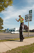 25 year old Neil Sauter enjoys an ice cream cone he received from a supporter in Charlevoix during his walk on stilts across Michigan to raise money and awarness for Cerebral Palsy.  Suater is walking from Toledo, Ohio to Ironwood, Michigan and hopes to raise $10,000.00.