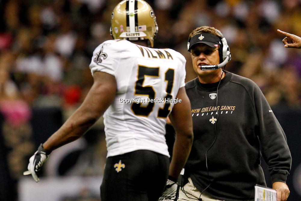 October 23, 2011; New Orleans, LA, USA; New Orleans Saints defensive coordinator Gregg Williams talks with linebacker Jonathan Vilma (51) during the third quarter of a game against the Indianapolis Colts at the Mercedes-Benz Superdome. The Saints defeated the Colts 62-7. Mandatory Credit: Derick E. Hingle-US PRESSWIRE / © Derick E. Hingle 2011