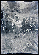 toddler standing in garden France circa 1920s