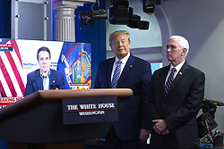 United States President Donald J. Trump, joined by United States Vice President Mike Pence, listen to a video of New York Governor Andrew Cuomo during a news conference in the James S. Brady Press Briefing room at the White House in Washington D.C., U.S., on Sunday April 19, 2020. Speaker of the United States House of Representatives Nancy Pelosi (Democrat of California) stated that lawmakers are close to a deal with United States Secretary of the Treasury Steven T. Mnuchin regarding a second round of small business loans for businesses impacted by Coronavirus. Credit: Stefani Reynolds / CNP