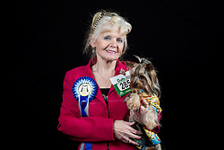 © Licensed to London News Pictures. 10/03/2016. Birmingham, UK. Brenda Haslan with her Yorkshire Terrier named Kit at Crufts 2016 held at the NEC in Birmingham, West Midlands, UK. The world's largest dog show, Crufts is this year celebrating it's 125th anniversary. The annual event is organised and hosted by the Kennel Club and has been running since 1891. Photo credit : Ian Hinchliffe/LNP