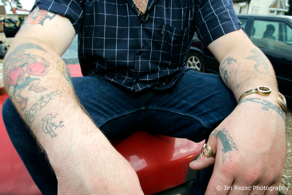 UK ENGLAND NORFOLK SWAFFHAM 14JUL05 - Micheal Carroll, a 22-year old binman who turned a millionnaire by winning £ 9.7 million in the National Lottery displays his tattoos on his arms sitting on the bonnett of an old banger car he intends to race and crash on a 3-acre field behind his estate in Swaffham, Norfolk. The self-styled 'King of Chavs' was recently served with an anti-social behaviour order after driving through Downham Market in Norfolk firing ball bearings from his window. He is also currently under an extended driving ban for driving without a licence and valid insurance...jre/Photo by Jiri Rezac..© Jiri Rezac 2005..Contact: +44 (0) 7050 110 417.Mobile:  +44 (0) 7801 337 683.Office:  +44 (0) 20 8968 9635..Email:   jiri@jirirezac.com.Web:    www.jirirezac.com