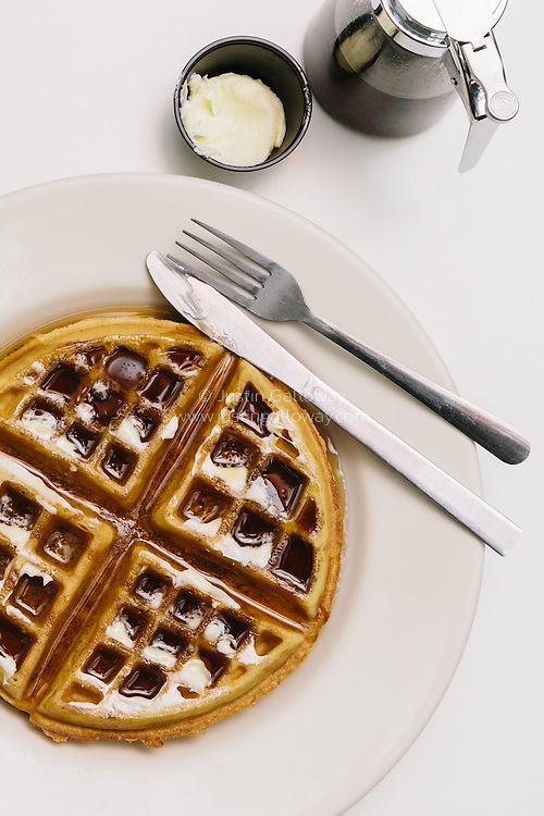 food editorial photograph of waffle on plate for magazine story in San Diego