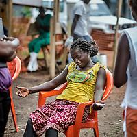 21/04/2014. Gueckedou. Guin&eacute;e Conakry.  <br /> <br /> Deux jours apr&egrave;s avoir &eacute;tait test&eacute;e positive &agrave; l'Ebola, Finda Marie Kamano d&eacute;c&egrave;de.<br /> Fatou sa grande soeur est accabl&eacute;e, c'est elle qui a appel&eacute; MSF pour venir chercher Finda. Certains membres de sa communaut&eacute; l'accusent d'&ecirc;tre coupable de sa mort. Ils affirment que si elle &eacute;tait rest&eacute;e chez elle Finda serait encore vivante.<br /> Il y a une grande m&eacute;connaissance du travail de MSF sur place, les gens voient partir des membres de leur famille dans le centre d'isolation et ils ne les revoient plus vivants. Beaucoup de fausses rumeurs circulent dans les communaut&eacute;s, certains parlent m&ecirc;me de traffic d'organes.<br /> <br /> Two days after was tested positive for Ebola, Finda Marie Kamano dies.<br /> Fatou her older sister is defeated, it was she who called MSF to come and get Finda. Some members of the community accuse her of being guilty of his death. They say that if she had stayed in her Finda would still be alive.<br /> There is a great ignorance of MSF's work on site, people see from their family members enter in the isolation center and they are reviewing they dead. Many false rumors in the community. People even speak about a traffic of organs.<br /> <br /> <br /> &copy;Sylvain Cherkaoui/Cosmos/MSF