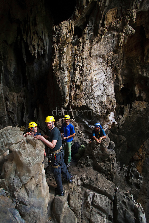 Spelunkers (cavers) prepare to descend into Mae On Cave at Crazy Horse Buttress, Chiang Mai, Thailand