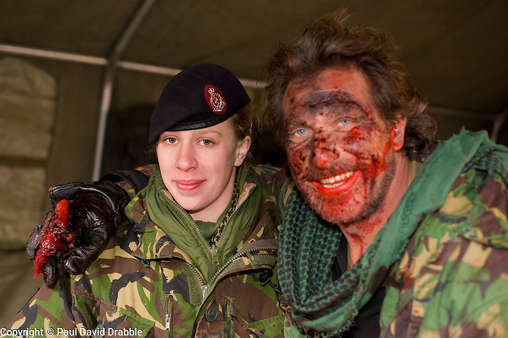 "4 Mechanized Brigade (4 Mech Bde) taking part in the Mission Specific Training on Salisbury Plain Training Area before deploying for the first time to Afghanistan where they will replacing 11 Light Brigade as the lead formation of British troops in Helmand province. - Combat Medical Technician  Pvt Natalie Jaques from Swinton of 3 Medical Regiment trains with a simulated battle casualty Daren ""Swifty"" Swift from the group ""Amputees In Action"" who provided real amputees. The addition of  stage makup provideds realistic casualties to help make the training as authentic,  as possible. . Helmand Province will be Natalies first Foreign  Posting since she joined the Army. (9 February 2010)"