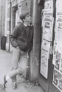 Teenage boy studies SWP Miners Strike poster, London, UK, 1984