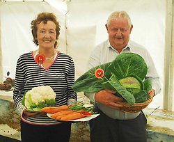 Brenda Lally and Sean Lydon pictured at the Tourmakeady Show with prize winning carrots and cabbage...Pic Conor McKeown