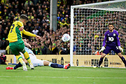 Norwich City midfielder Emi Buendia (17) gets in a shot during the EFL Sky Bet Championship match between Norwich City and Blackburn Rovers at Carrow Road, Norwich, England on 27 April 2019.