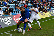 Gillingham FC forward Tom Eaves (9) and Coventry City defender Brandon Mason  (3) battle for the ball in front of the Ginsters hoarding during the EFL Sky Bet League 1 match between Gillingham and Coventry City at the MEMS Priestfield Stadium, Gillingham, England on 25 August 2018.