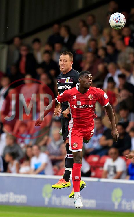 John Terry of Aston Villa wins a header from Amadou Bakayoko of Walsall - Mandatory by-line: Paul Roberts/JMP - 18/07/2017 - FOOTBALL - Bescot Stadium - Walsall, England - Walsall v Aston Villa -  Pre-season friendly