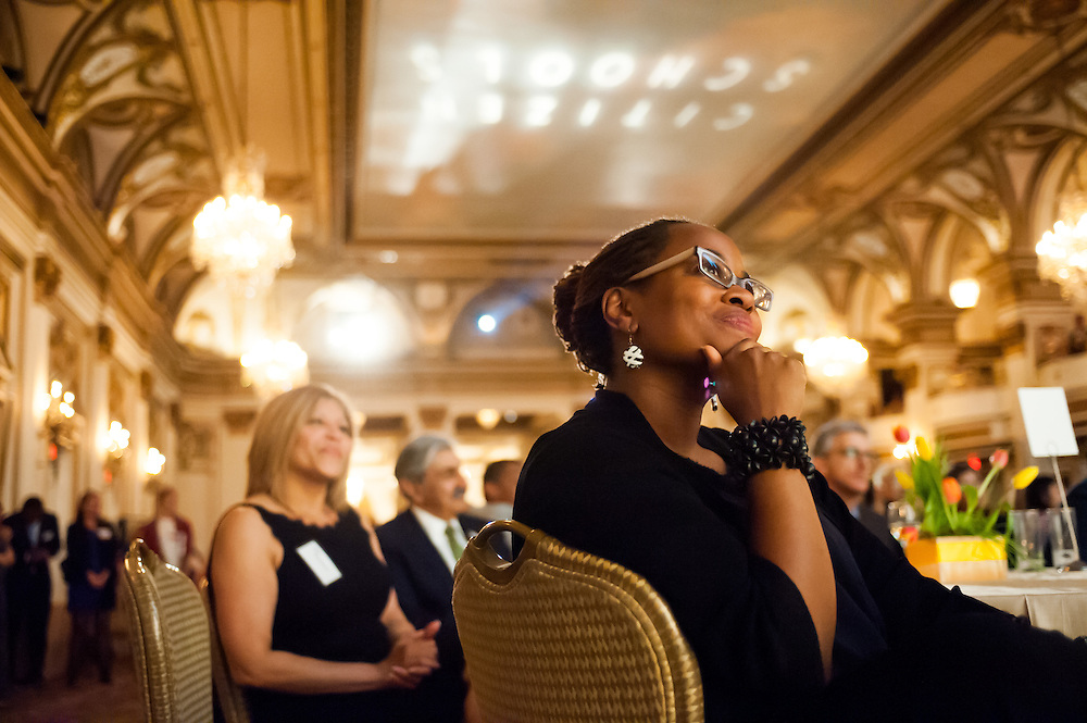 A Citizen Schools Gala attendee enjoying a video presentation at the Copley Plaza Hotel in Boston, MA.