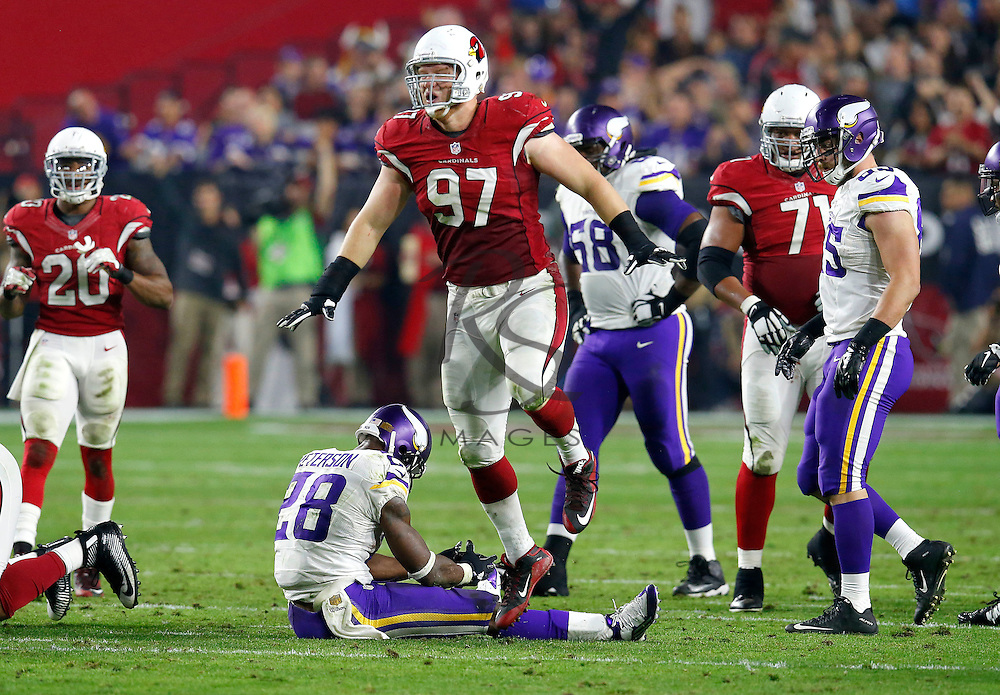 Minnesota Vikings running back Adrian Peterson (28) sits on the field after fumbling as Arizona Cardinals nose tackle Josh Mauro (97) celebrates during the second half of an NFL football game, Thursday, Dec. 10, 2015, in Glendale, Ariz. The Cardinals recovered the ball. (AP Photo/Rick Scuteri)