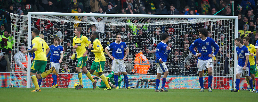 NORWICH, ENGLAND - Saturday, February 23, 2013: Everton's Phil Jagielka looks dejected as Norwich City score an equalising goal to level the scores 1-1 during the Premiership match at Carrow Road. (Pic by David Rawcliffe/Propaganda)