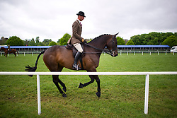 © London News Pictures. 08/05/2012. Windsor, UK.  A rider exercising his horse before competition on day one of the Royal Windsor Horse Show, set in the grounds of Windsor Castle. Established in 1943, this year will see the Show celebrate its 70th anniversary. Photo credit: Ben Cawthra/LNP