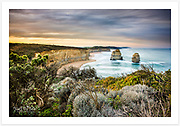 The wild coastline of Port Campbell National Park under an autumn morning sky, looking east from the Twelve Apostles viewing platform [Great Ocean Road, Victoria, Australia]<br />