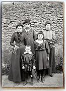 family posing  outside vintage group portrait France