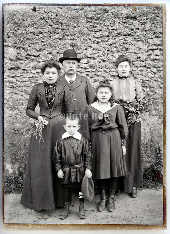 family posing  outside vintage group portrait France