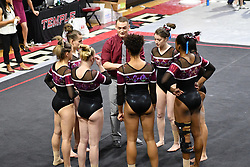March 9, 2018 - Philadelphia, Pennsylvania, U.S - Temple Owls gymnastics assistant coach MICHAEL RUSSO talks with the Owls floor exercise competitors during a meet held in Philadelphia, PA. Temple finished second to Maryland in the tri-meet. (Credit Image: © Ken Inness via ZUMA Wire)
