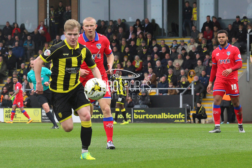 Burton Albion defender Damien McCrory first to the ball during the Sky Bet League 1 match between Burton Albion and Oldham Athletic at the Pirelli Stadium, Burton upon Trent, England on 26 March 2016. Photo by Aaron Lupton.