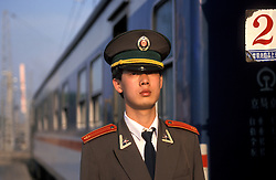 CHINA BEIJING APR99 - A train guard stands next to a second class train carriage bound for Shanghai at Beijing main station...jre/Photo by Jiri Rezac..© Jiri Rezac 1999..Contact: +44 (0) 7050 110 417.Mobile:  +44 (0) 7801 337 683.Office:  +44 (0) 20 8968 9635..Email:   jiri@jirirezac.com.Web:     www.jirirezac.com..© All images Jiri Rezac 1999 - All rights reserved.