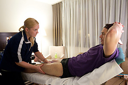 Physiotherapist Manca Marc and Ziga Pavlin of Slovenian National Ice Hockey team in a massage room in the hotel Holiday Inn at IIHF 2011 World Championship Slovakia, on May 4, 2011 in Bratislava, Slovakia. (Photo By Vid Ponikvar / Sportida.com)