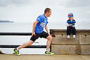 06/08/2012 No fee for Repro: Jack Harvey (2) from Bray Co Wicklow is pictured getting ready to time his dad Dave as he prepairs to take part in the DLR Bay 10K road race. Pic Jason Clarke Photography