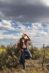 cowboy with his head covered by his cowboy hat standing outdoors in New Mexico