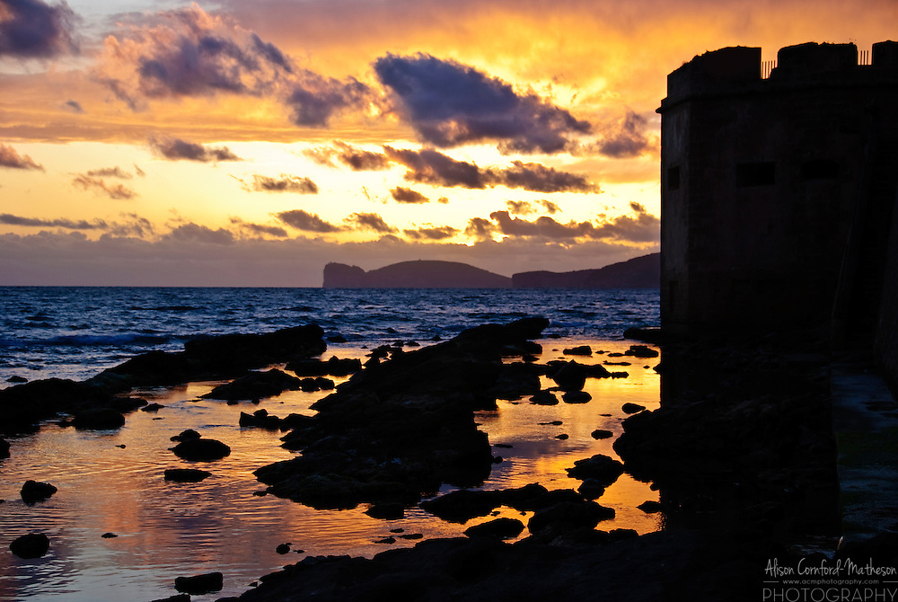 Sunset over Capo Caccia point in Sardinia, Italy.