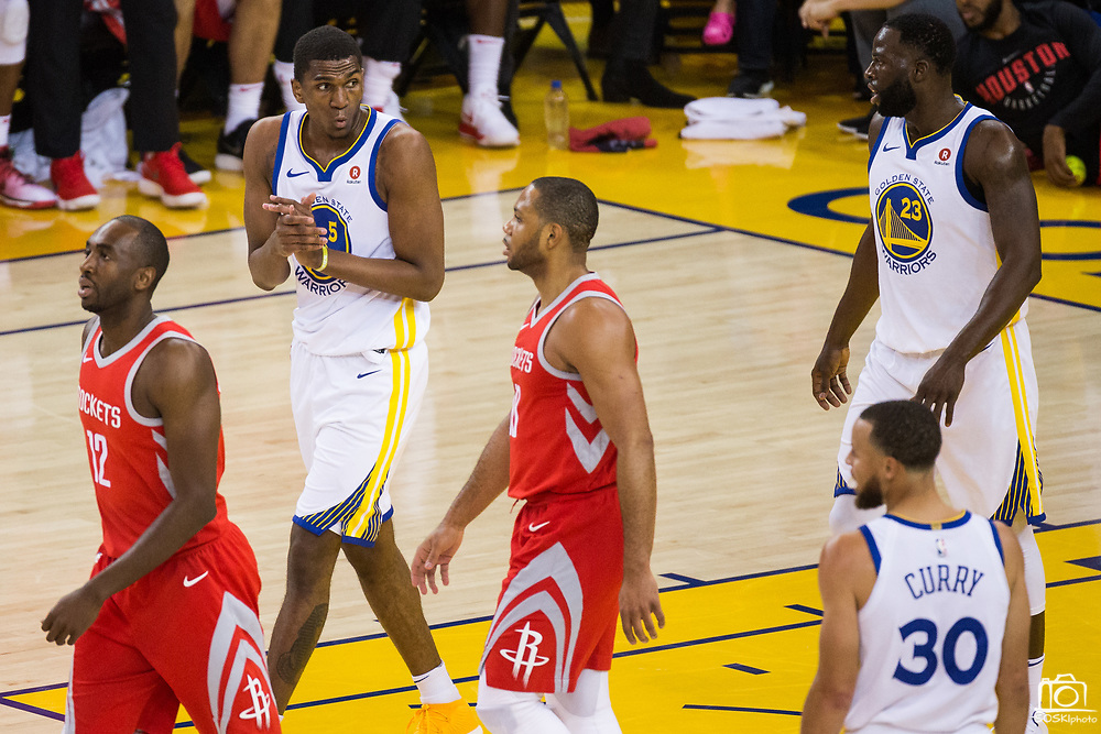 Golden State Warriors forward Kevon Looney (5) reacts to a Houston Rockets turnover during Game 3 of the Western Conference Finals at Oracle Arena in Oakland, Calif., on May 20, 2018. (Stan Olszewski/Special to S.F. Examiner)