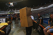 Garret Gregorek carries a box backstage while preparing for the Stihl Timbersports Championships at The Norfolk Scope in Norfolk, Virginia on June 19, 2014.
