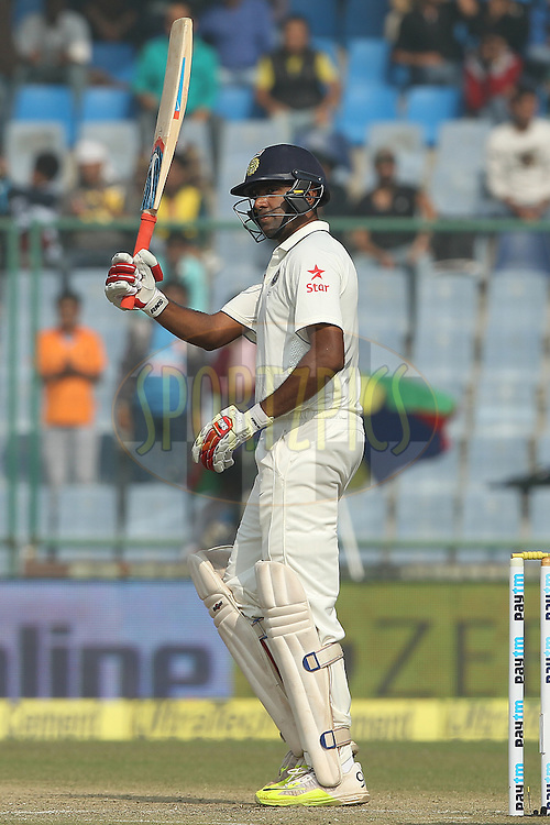 Ravichandran Ashwin of India celebrates his fifty during day two of the 4th Paytm Freedom Trophy Series Test Match between India and South Africa held at the Feroz Shah Kotla Stadium in Delhi, India on the 4th December 2015<br /> <br /> Photo by Ron Gaunt  / BCCI / SPORTZPICS