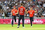 Wicket - Liam Plunkett of England celebrates taking the final wicket to beat Australia as Eoin Morgan of England and Jason Roy of England race in to celebrate with him during the International T20 match between England and Australia at Edgbaston, Birmingham, United Kingdom on 27 June 2018. Picture by Graham Hunt.