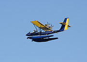 Large blue and yellow sea ultra light plane giving air tours of Jekyll Island.