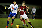Bury Town defender Mihai Dobre (21) and Northampton Town defender Ash Taylor (6) during the EFL Sky Bet League 1 match between Northampton Town and Bury at Sixfields Stadium, Northampton, England on 25 November 2017. Photo by Nigel Cole.