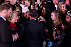 Self-proclaimed Muslims for Clinton supporter Jonathan-Lee Riches, of Philadelphia, is seen in close proximity of Democratic presidential nominee Hillary Clinton she greets voters after a October 4, 2016 Family Town Hall event in Haverford, Pennsylvania, USA.