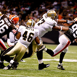 Oct 24, 2010; New Orleans, LA, USA; Cleveland Browns linebacker Scott Fujita (99) is tackled by New Orleans Saints guard Carl Nicks (77) as he runs back an interception during the first half at the Louisiana Superdome. Mandatory Credit: Derick E. Hingle