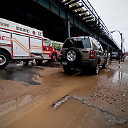 June 14, 2009 - Bronx, NY : Construction crews and emergency workers work to clean up and restore services to the intersection of Broadway and W. 231st St. where a water main broke overnight, leaving much of the community without water, and much of the neighborhood under water.  A torrent of water pushed mud into the streets.