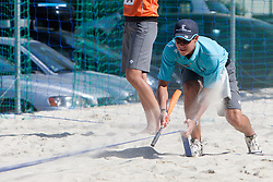 Cleaning the lines at A1 Beach Volleyball Grand Slam presented by ERGO tournament of Swatch FIVB World Tour 2012, on July 18, 2012 in Klagenfurt, Austria. (Photo by Matic Klansek Velej / Sportida)