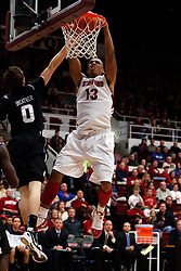 Dec 22, 2011; Stanford CA, USA;  Stanford Cardinal forward/center Josh Owens (13) dunks over Butler Bulldogs guard/forward Andrew Smeathers (0) during the first half at Maples Pavilion.  Mandatory Credit: Jason O. Watson-US PRESSWIRE