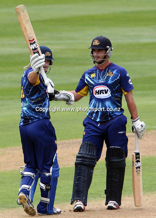 Nathan McCullum acknowledges his team-mates after scoring 50 runs.<br /> Twenty20 Cricket - HRV Cup, Otago Volts v Central Stags, 6 January 2013, University Oval, Dunedin, New Zealand.<br /> Photo: Rob Jefferies / photosport.co.nz