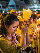 05 MAY 2104 - BANGKOK, THAILAND:  A candlelight vigil for Bhumibol Adulyadej, the King of Thailand, on Ratchadamnoen Ave in front of Sanam Luang in Bangkok. Thousands of Thais packed the area around Sanam Luang and the Grand Palace Monday evening for a special ceremony to mark Coronation Day, which honored the 64th anniversary of the coronation of Bhumibol Adulyadej, the King of Thailand. Many of the people also support the anti-government movement led by Suthep Thaugsuban. Most of the anti-government protesters are conservative supporters of the monarchy.   PHOTO BY JACK KURTZ