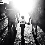 A family with a young kid walk together on a sunday afternoon in Caracas downtown. Family rupture is one of the main issues in actual Venezuelan society and is at the base of many youth problems.