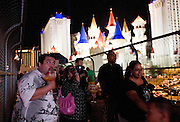 Tourists admire the view near the Excalibur hotel in Las Vegas, Nevada.