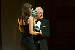 CARDIFF, WALES - Monday, December 5, 2016: Double Olympic Taekwondo Champion Jade Jones is presented with the BBC Wales Sports Personality of the Year 2016 trophy by Sir Gareth Edwards at the Wales Sport Awards Wales Sport Awards 2016 at the Millennium Centre. (Pic by Ian Cook/Propaganda)