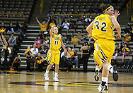 26 JANUARY 2009: Iowa guard Kristi Smith (11) points to Iowa forward Wendy Ausdemore (32) after an assist during the first half of an NCAA women's college basketball game Monday, Jan. 26, 2009, at Carver-Hawkeye Arena in Iowa City, Iowa. Iowa defeated Michigan 77-69.