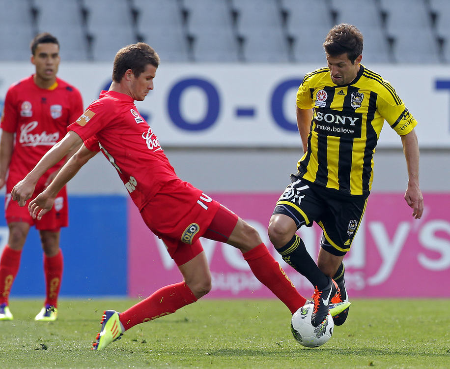 Wellington Phoenix's Vince Lia is tackled by Adelaide United's Dario Vidosic in the Hyundri football A-league match, Eden Park, Auckland, New Zealand, Saturday, November 19, 2011.  Credit:SNPA / David Rowland