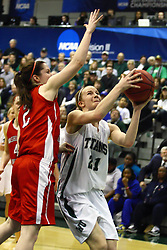 18 March 2011: Nikki Preston concentrates on the hoop while Alex Hoover looks for a block during an NCAA Womens basketball game between the Washington University Bears and the Illinois Wesleyan Titans at Shirk Center in Bloomington Illinois.